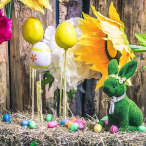 Green easter bunny with eggs on sticks
