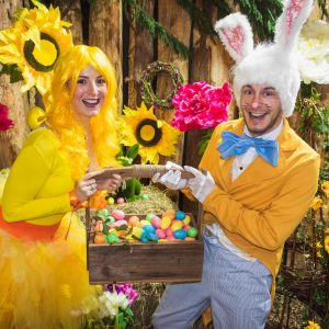 Happy easter actors holding a large box of eggs