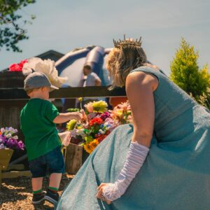 Toddler looking at flowers with the Fairy Godmother