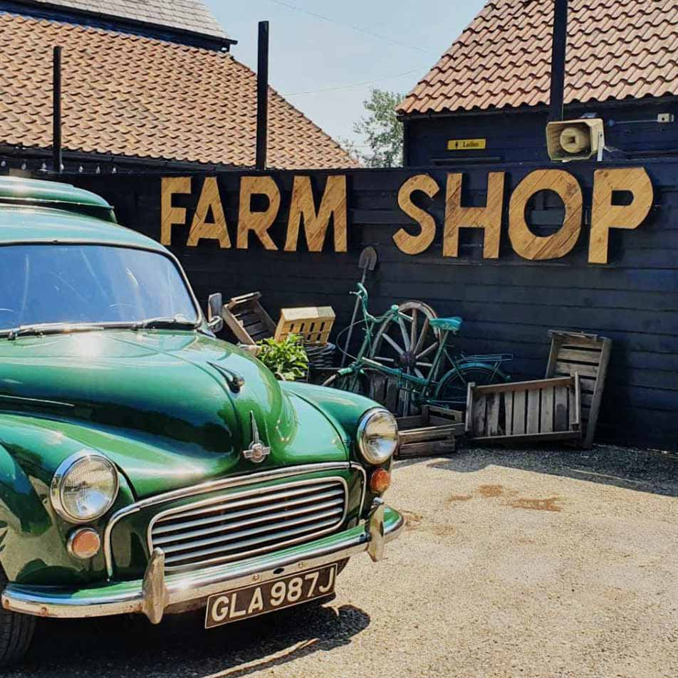 A wooden sign saying Farm Shop
