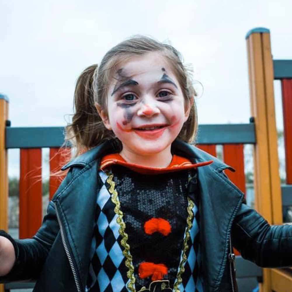 Little girl with scary clown make-up on