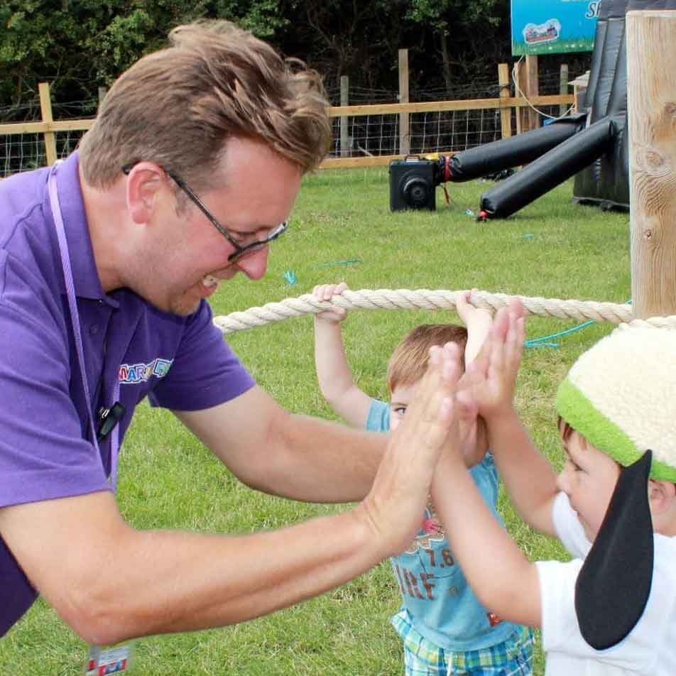 Member of staff keeping children happy