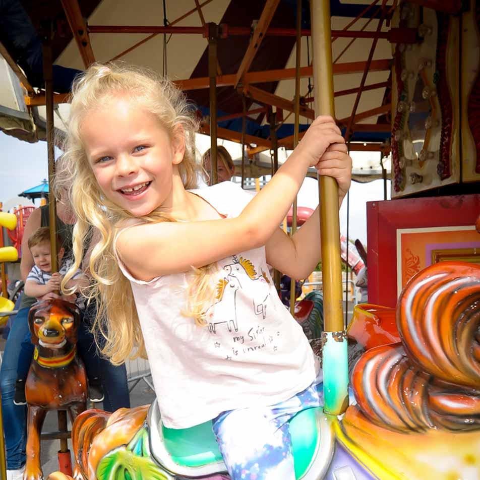 Child having fun on a carousel