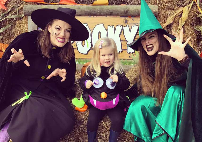 Two witches with a little girl